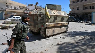 Kurdish-led SDF forces have reportedly spurred some Syrian Arabs to back ISIL as fighting goes on [Rodi Said/Reuters]