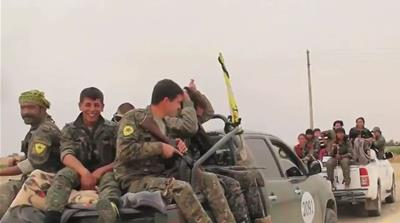 US forces angered Ankara by wearing YPG badges while supporting the group against ISIL [Al Jazeera]