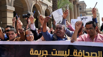 Egyptian journalists protest outside the Egyptian Press Syndicate in downtown Cairo, Egypt [EPA]