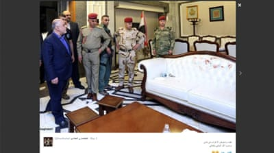 Iraqis mock politicians' reaction to stained white sofa