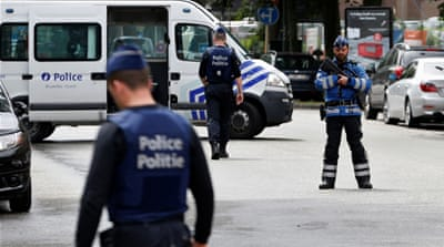 Belgium arrests 12 in late-night security raids
