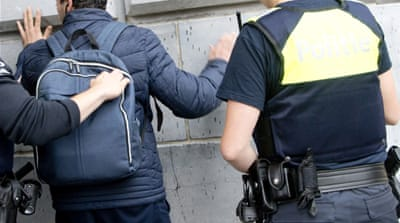Belgium charges three men after security raids