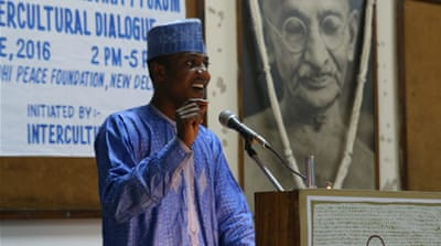 Zaharaddeen Muhammed, a master's degree student from Nigeria living in India, speaks at the Africa-India Solidarity Forum in New Delhi [Aletta Andre/Al Jazeera]