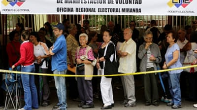 Venezuelans lined up around the country to validate signatures [Ivan Alvarado/Reuters]