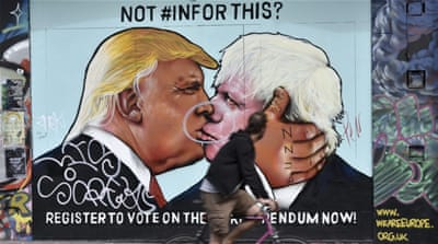 A painted image of former London Mayor Boris Johnson and US Presidential candidate Donald Trump in Bristol, England [EPA]