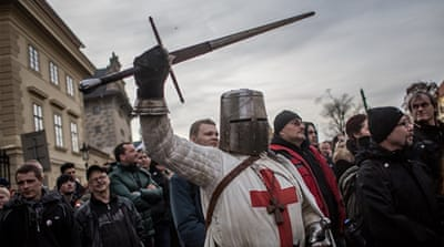 A participant dressed as Crusader holds a sword during an anti-Islam protest in Prague, Czech Republic [Getty Images]