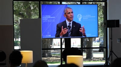 Obama on a TV screen as he delivers an address at Stanford University on Friday [Robert Kennedy/Al Jazeera]