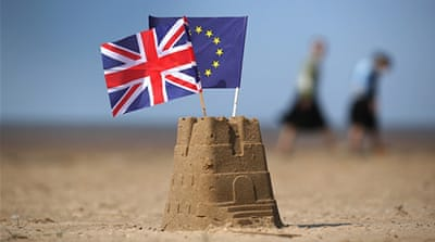 The flag of the European Union and the Union flag sit on top of a sandcastle on a beach in Southport, United Kingdom [Getty]