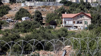 Israeli ministers have approved millions of dollars for Jewish-only settlements in the occupied West Bank [File: Mussa Qawasma/Reuters]