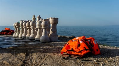 Making a giant chessboard from refugee life jackets