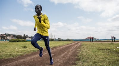 Refugee athlete Yiech Pur Biel, pictured in yellow, says he is feeling 'a lot of pressure in so many ways' [Fredrik Lerneryd/Al Jazeera]