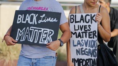 A small group of Black Lives Matter protesters meet on the Ronald Kirk Pedestrian Bridge in Dallas, Texas [EPA]