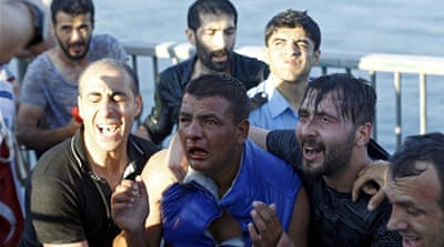 Civilians beat a soldier after he surrendered on the Bosphorus Bridge in Istanbul. [Murad Sezer/Reuters]