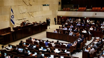Last week, the Israeli parliament passed controversial legislation that sets a jail term of three to 15 years for people who seek to persuade a volunteer to quit the military [Ronen Zvulun/Reuters]