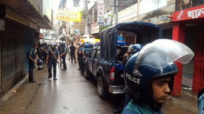 Police cordoned off the neighbouring areas of Kalyanpur in Dhaka [Mahmud Hossain Opu/Al Jazeera]