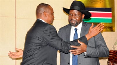 Kiir (right) embraces Deng after his swearing-in ceremony as first vice president [Jok Solomun/Reuters]