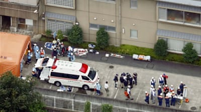 Police officers and rescue workers are seen in a facility for the disabled, where residents were killed and wounded by a knife-wielding man, in Sagamihara, Kanagawa prefecture, Japan, in this photo taken by Kyodo July 26, 2016. [Kyodo/Reuters]