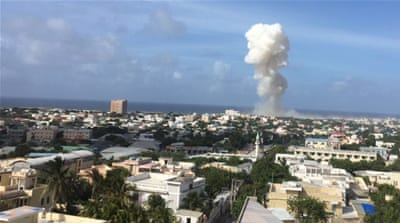 The first blast happened near an AU base, which is beside Mogadishu's main airport [Abdirizak Mohamud Tuuryare/Al Jazeera]