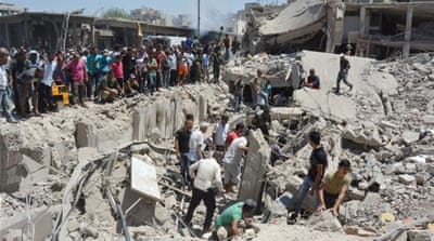 The death toll from Wednesday's attack in Qamishli is feared to rise [Rodi Said/Reuters]
