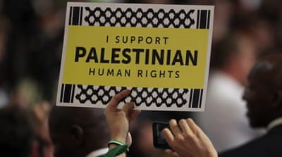 A delegate holds a sign reading 'I support Palestinian Human Rights' at the Democratic convention in Philadelphia [Tannen Maury/EPA]