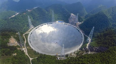 Construction on the 500-metre diameter radio telescope began in 2011 [Xinhua news agency/AP]