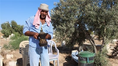 Aziz al-Turi rushed to save this antique Syrian coffee pot when the demolition team arrived in Araqib [Nigel Wilson/Al Jazeera]