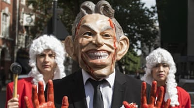 Protesters dressed as Tony Blair hold a demonstration as they wait for the release of the Chilcot Inquiry in London, Britain [EPA]
