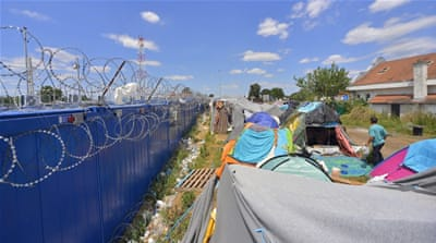 Hungary's strict border controls have left hundreds of refugees stranded on the border  [Edvard Molnar/EPA]