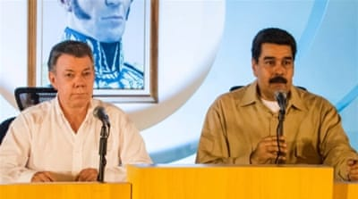 Santos, left, and Maduro plan to open five pedestrian crossings [Miguel Gutierez/EPA]
