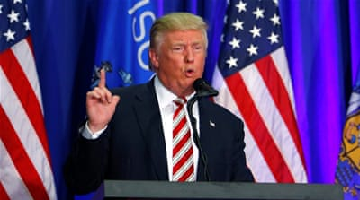 Reports says Trump's recent drop in the polls prompted him to shake up his campaign team [Reuters]