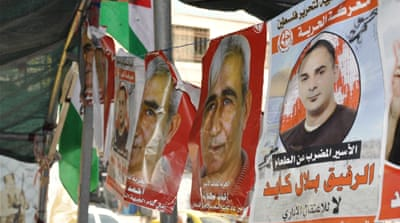 Posters of Bilal Kayed and PFLP Secretary-General Ahmad Saadat have been hung in Duheisha refugee camp in the occupied West Bank city of Bethlehem [Emily Mulder/Al Jazeera]