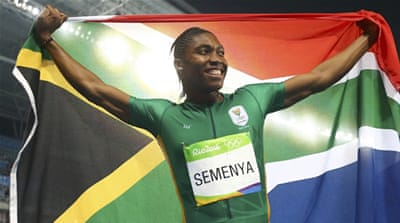 Caster Semenya, centre, of South Africa celebrates winning the gold medal for 800m heat [Jae C. Hong/AP]