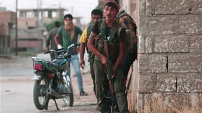 The fighting in Hasaka marks the most violent confrontation between the Kurdish YPG and the Syrian army [Rodi Said/Reuters]