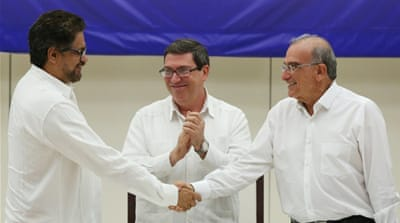 The peace deal was signed in Cuba's capital Havana after nearly four years of talks [Alexandre Meneghini/Reuters]
