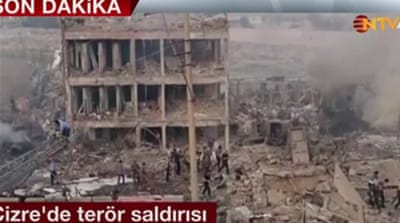 Turkish television showed live footage of rubble left from the building [NTV television]