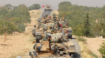 Turkey has deployed dozens of tanks into neighbouring Syria [Reuters]