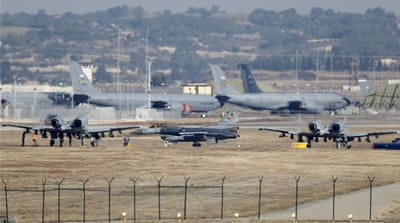 File: A Turkish Air Force F-16 fighter jet pictured in the centre foreground [Umit Bektas/Reuters]