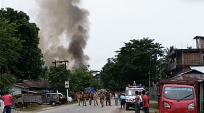 Attackers kill 13 at busy market in India's Assam