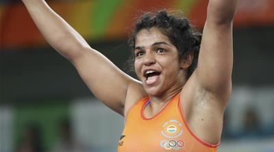 Sakshi Malik of India celebrates winning the bronze medal after her victory against Kyrgyzstan's Aisuluu Tynybekova [Toru Hanai/Reuters]