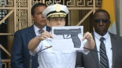Police chief Kim Jacobs shows reporters a replica of the BB gun that King was allegedly holding [Reuters]