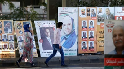 More than half of the respondents to a recent survey said they were unlikely to vote [Muhammad Hamed/Reuters]