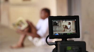 A boy acts out a scene during the making of Ake, a 2013 film based on the childhood memoirs of a Nigerian writer [Akintunde Akinleye/Reuters]