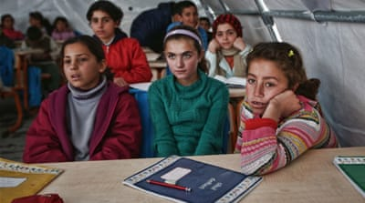 Syrian children listen to a teacher during a lesson in a temporary classroom in Suruc refugee camp on March 2015 in Turkey [Getty]