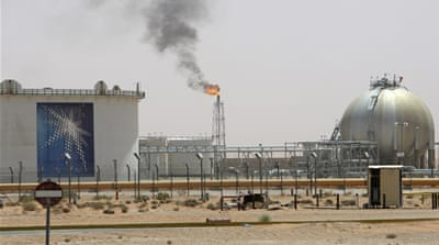 A gas flame is seen in the desert near the Khurais oilfield, about 160km from Riyadh [Ali Jarekji/Reuters]