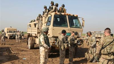 Iraqi soldiers participate in a training exercise with US and Spanish trainers outside Baghdad [The Associated Press]