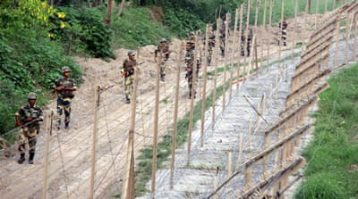 Indian Border Security Force soldiers patrol near the fence at the India-Pakistan border in Akhnoor sector [File: EPA]