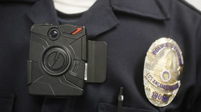 A Los Angeles police officer wears a body-worn camera during a demonstration in January 2014  [Associated Press]