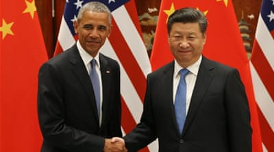 US president Barack Obama and Chinese president Xi Jinping shake hands during their meeting at the West Lake State Guest House in Hangzhou, China [EPA]