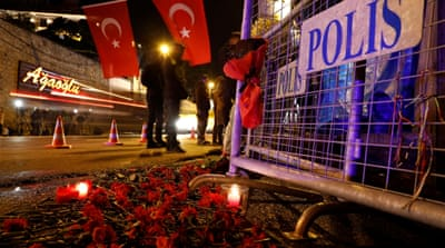 Flowers in front of a police barrier near the entrance of Istanbul's Reina nightclub [Umit Bektas/Reuters]