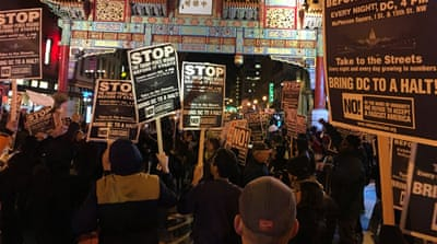 About 100 people protested peacefully in the Chinatown neighbourhood of Washington DC led by a group calling itself Refuse Fascism [Gabriel Elizondo/Al Jazeera]